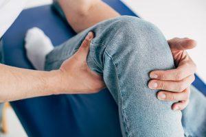 chiropractor adjusting leg